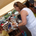 Passing Around Food at The Atlantic Club Family Fun Day